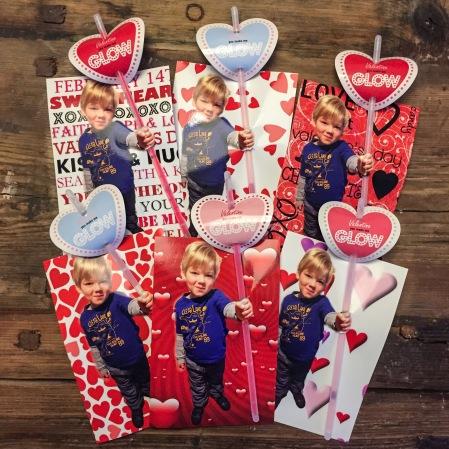Kid holding somthing valentine card